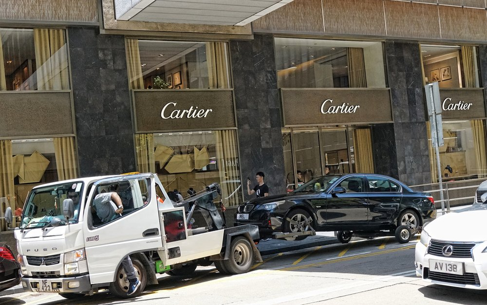 Car Being towed, Princes Building, Central, Hong Kong.JPG