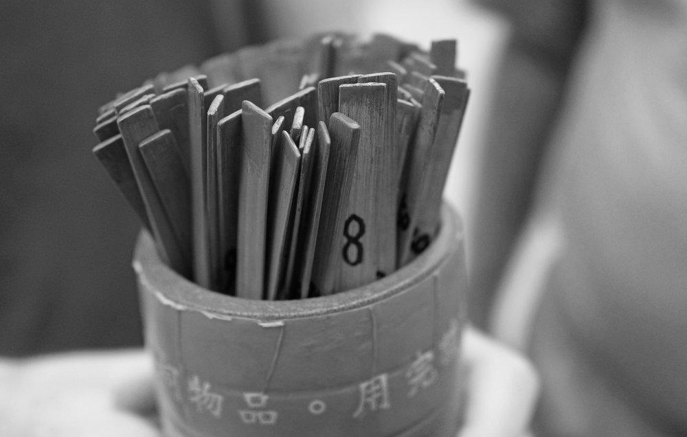 Shaking the sticks at the Sik Sik Yuen Wong Tai Sin Temple, Hong Kong.jpg