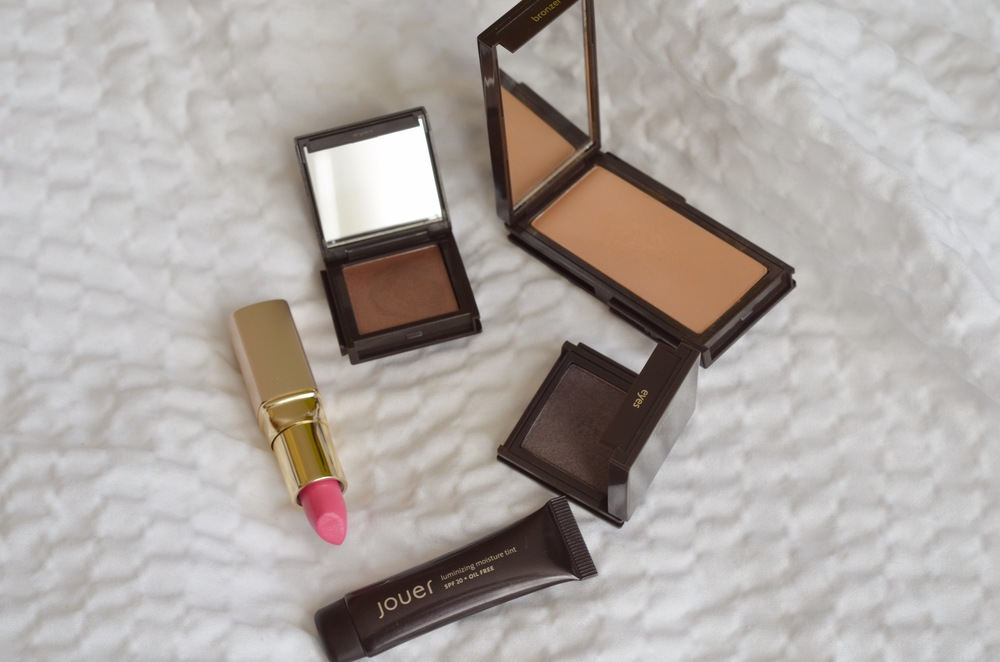 jouer luminizing moisture tint in glow, jouer creme eyeshadow in organza, jouer powder eyeshadow in caviar, jouer mineral bronzer in suntan, jouer moisturizing lipstick in whitney