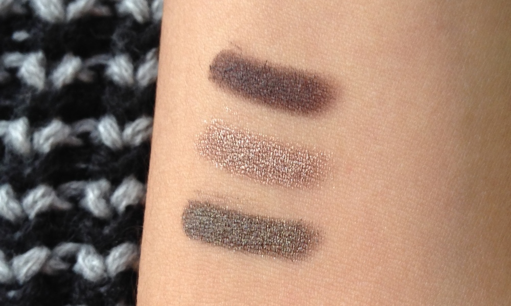 Swatches, Top to Bottom: Bobbi Brown Long Wear Cream Shadow Stick in Bark, By Terry Ombre Blackstar in Bronze Moon, Laura Mercier Caviar Stick in Khaki