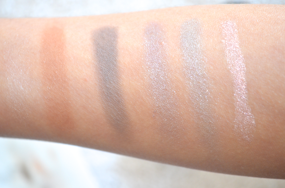 Swatches L-R: Nars Multiple Duo in Copacabana/St. Bart's, Maybelline Color Tattoo in Tough as Taupe, Maybelline Color Tattoo in Lavish Lavender, L'Oreal Infallible Eyeshadow in Flashback Silver, and Laura Mercier Caviar Stick in Pink Opal