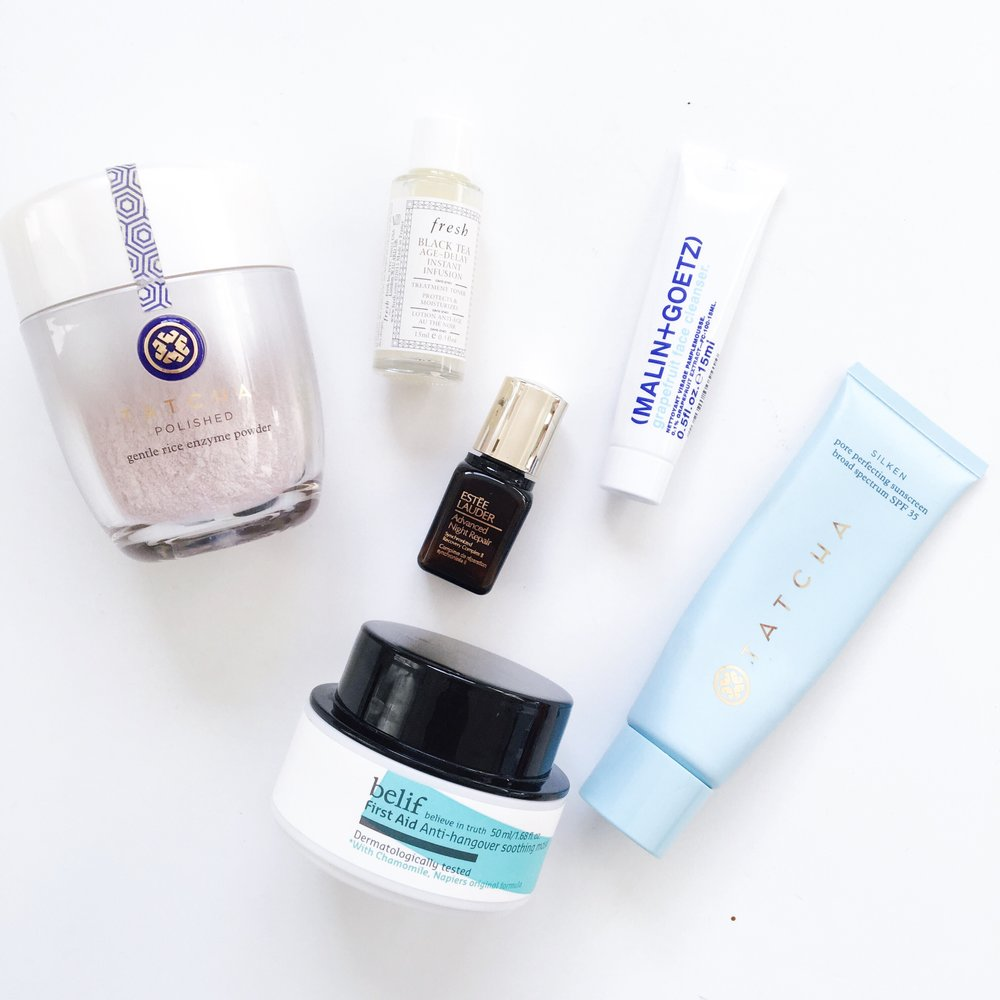 Malin + Goetz Grapefruit Face Cleanser, Belif First Aid Anti-hangover Soothing Mask, Tatcha Silken Pore Perfecting Sunscreen, Estee Lauder Advanced Night Repair Serum, Fresh Black Tea Age-Delay Instant Infusion