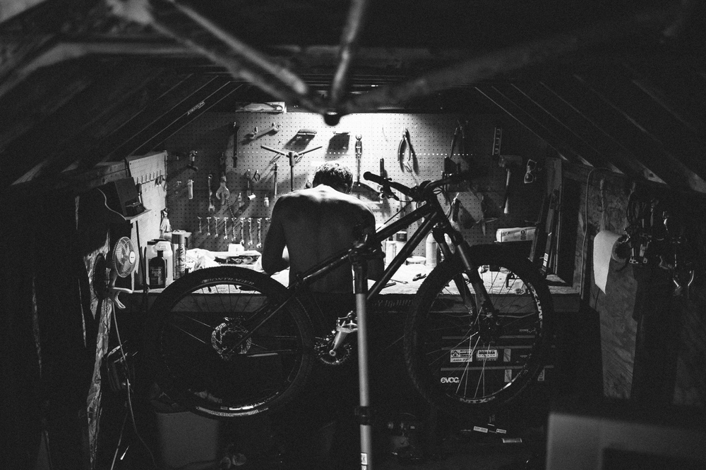 Colin Van Andel works on bikes in the old shed, Kelowna BC