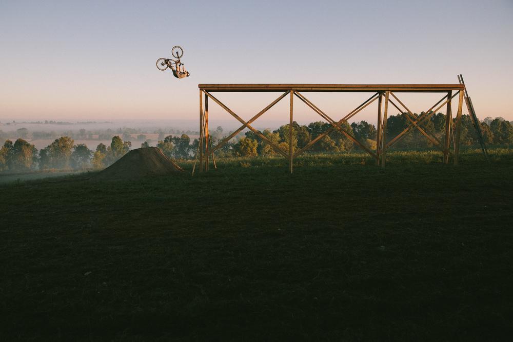 Brett Rheeder with a flip can drop off a muddy platform - Ontario Canada