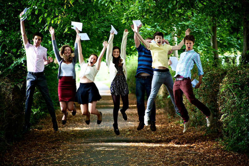 pupils from Cotswold School jumping for joy at exam results