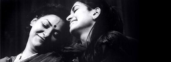 Harvey Virdi (Kamla) & Mala Ghedia (Nisha), Fourteen Songs, Two Weddings and a Funeral, 2001