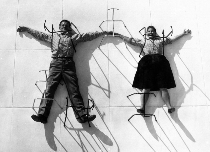 Charles and Ray Eames posing with chair bases© Eames Office LLC