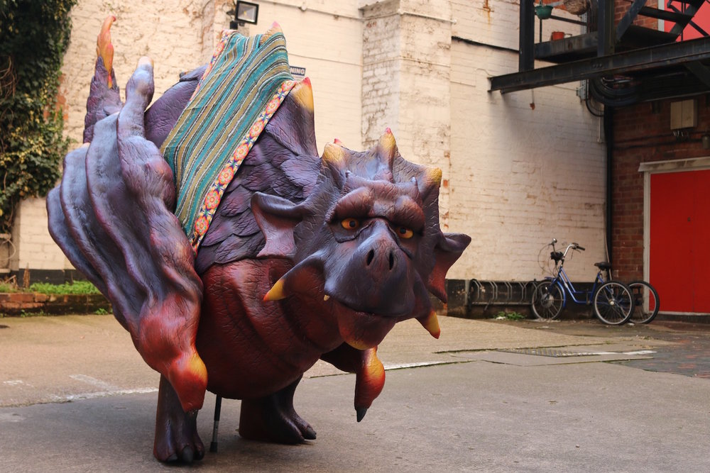 Cedric the Dragon in the Creature Works courtyard, built for Vectis Ventures.