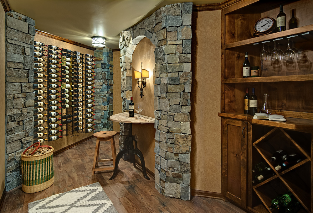 Wine Room Remodel We are pleased to have our wine room remodel featured in the Star Tribune. Previously, this space was an unfinished storage space. Now, the homeowners have a room that is dedicated to their passion and hobby and connects with the living room located just off of the wine room..