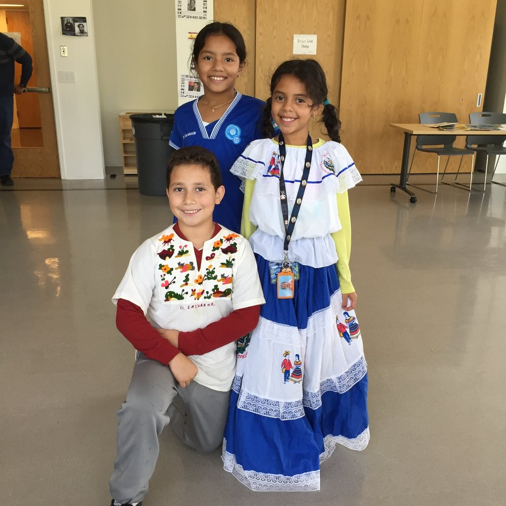 Hispanic Heritage Month October 2018. Three students in clothing representing their cultural background.