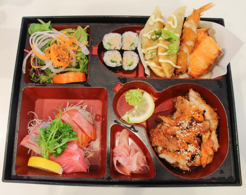 I-Bento Box: Teriyaki Chicken, Assorted Fresh Sashimi, Sushi Maki, Grilled Salmon, Gyoza, Tempura Prawn. Served with Rice, Miso Soup and Salad. ($24.00)