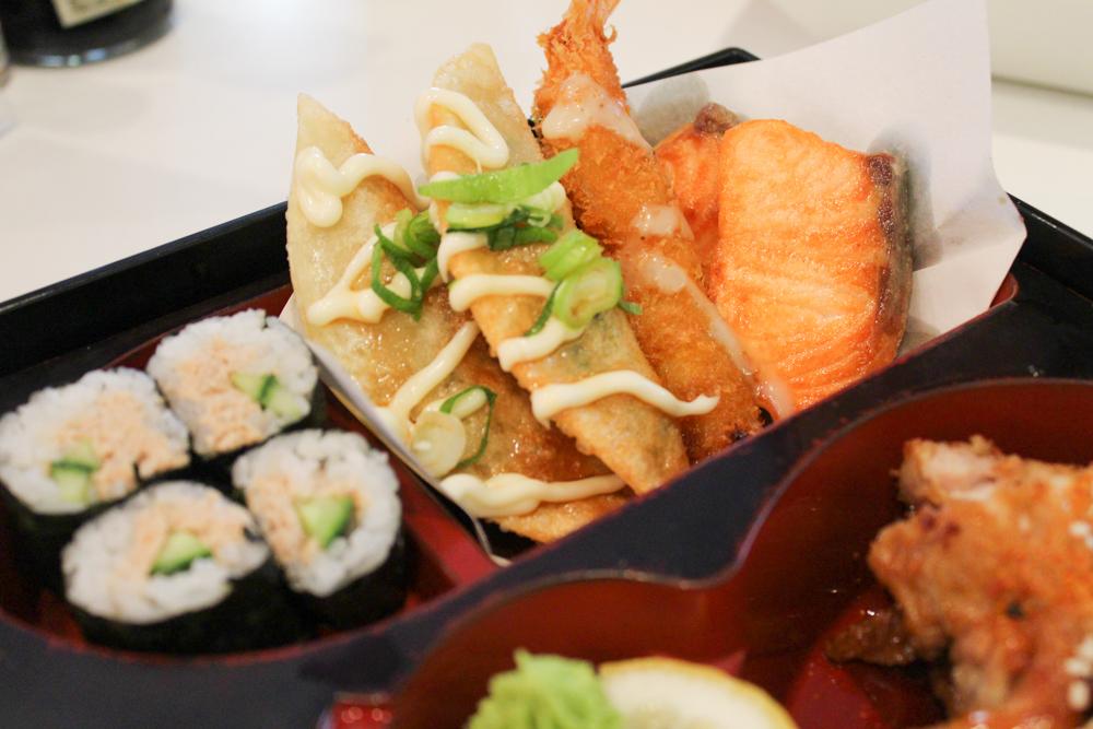 Tuna and Cucumber Maki, Gyoza, Tempura and Grilled Salmon Pieces.