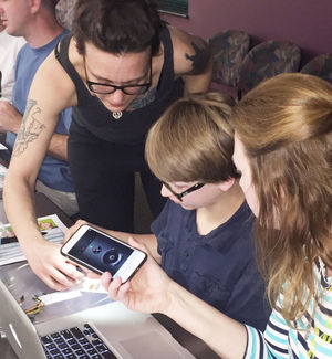 Jim McNally/Statesville Record & Landmark     Hannah Mishin (left) helps put Houston Finley on the right track while his mother, Ginger Finley, looks on. Mishin was the facilitator at a Leadership Statesville workshop held at the Iredell County Library last week that explained simple computer programs.