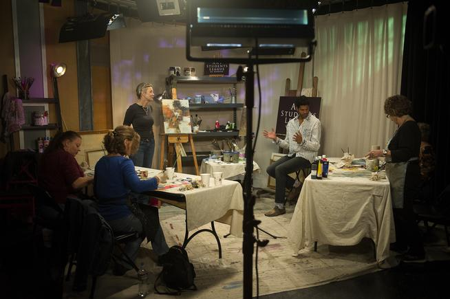 "Michael Gadlin, host of ""Art Scene,"" talks with Karen Roehl of Art Students League of Denver on Oct. 20 during a taping of the show in Studio D in the City and County Building. (Seth McConnell, YourHub)"