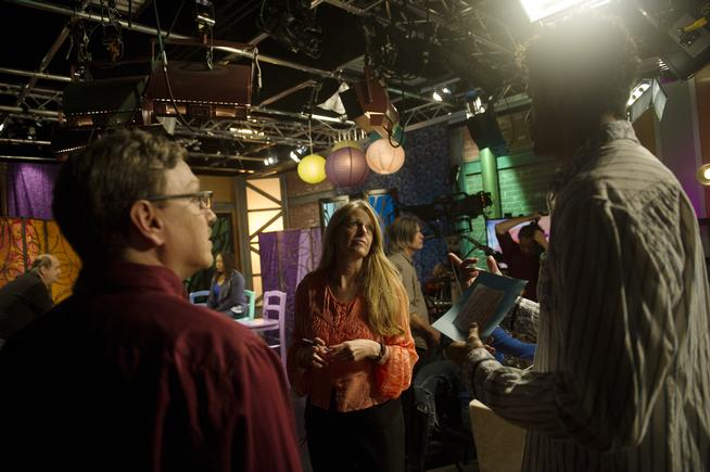 Producer Carol Pendergrass Caster, center, talks with Art Scene host Michael Gadlin between segments in Studio D in the City and County Building in Denver on Oct. 20, 2015. (THE DENVER POST | Seth McConnell)