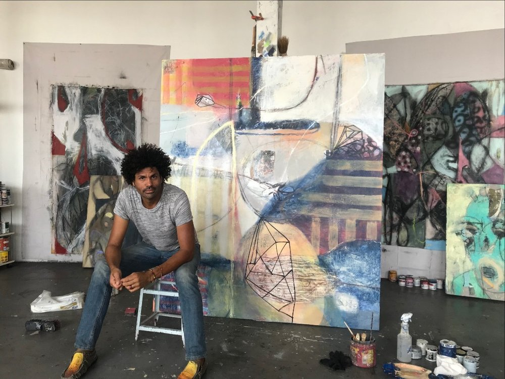 Michael in his Denver studio,  Nowthateyesee  (behind him), Mixed Media on panel, 80 x 72 inches [sold].