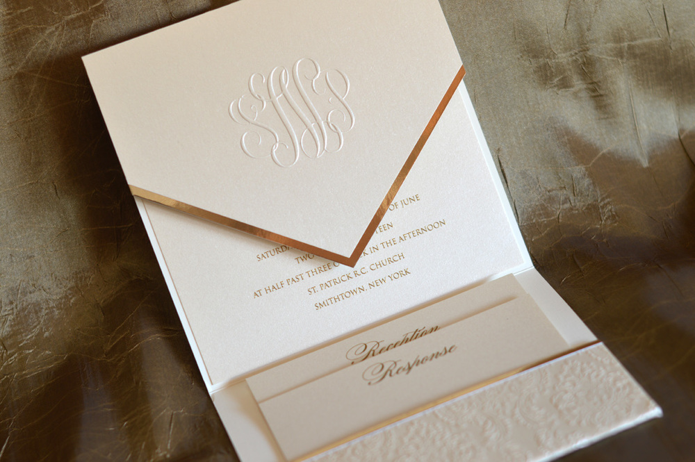 Wow! A pocket with multiple layers of paper, gold foil trim and a blind embossed monogram.