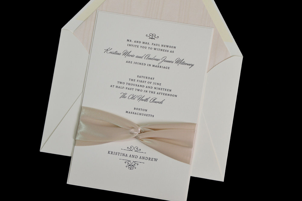 This lovely invitation features a uniquely intertwined ribbon treatment.