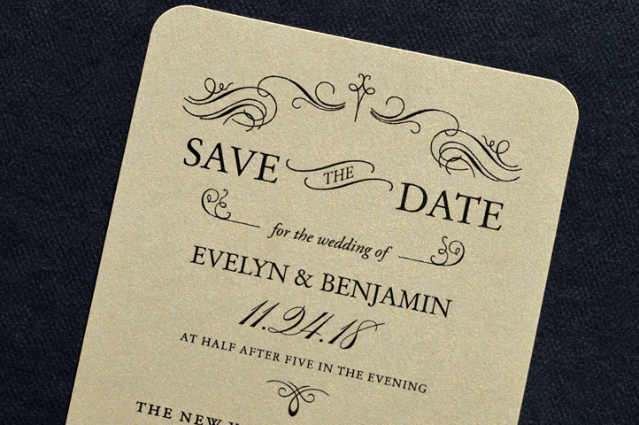 This elegant save the date features gold shimmer paper and a vintage inspired design and layout.