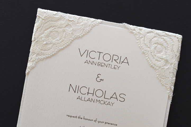 The corners of this invitation are covered in lace. Lovely!