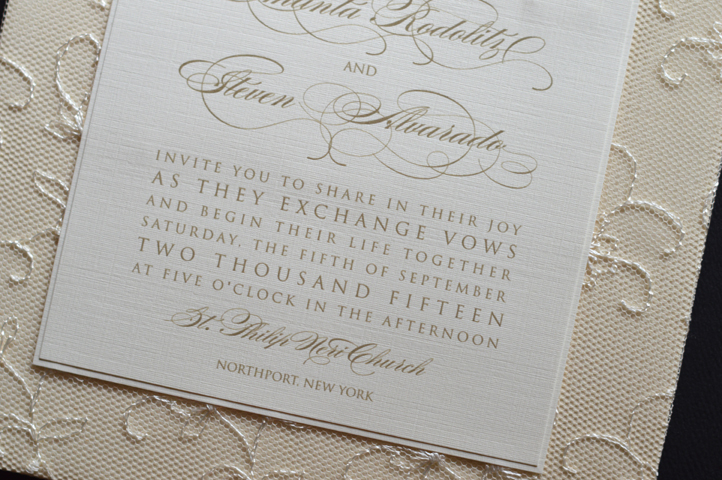 The bottom layer of this invitation is wrapped in lace.