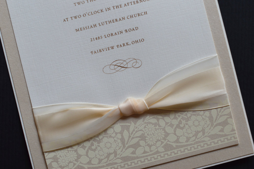 Multiple layers of paper topped off with a knotted ribbon!