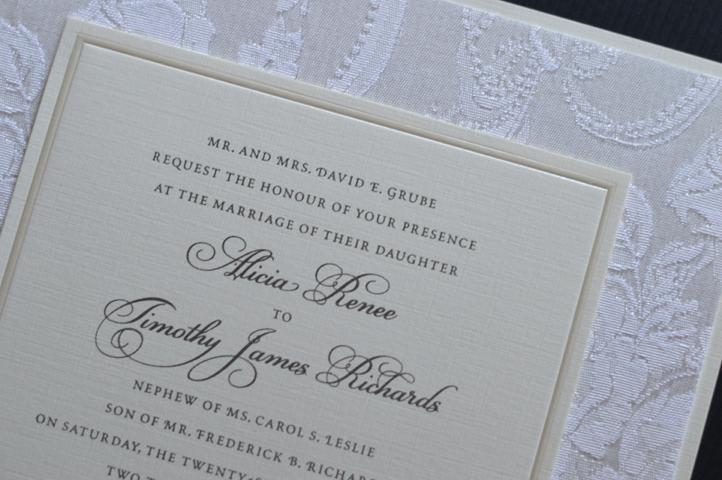 A multi-layered invitation featuring brocade fabric.