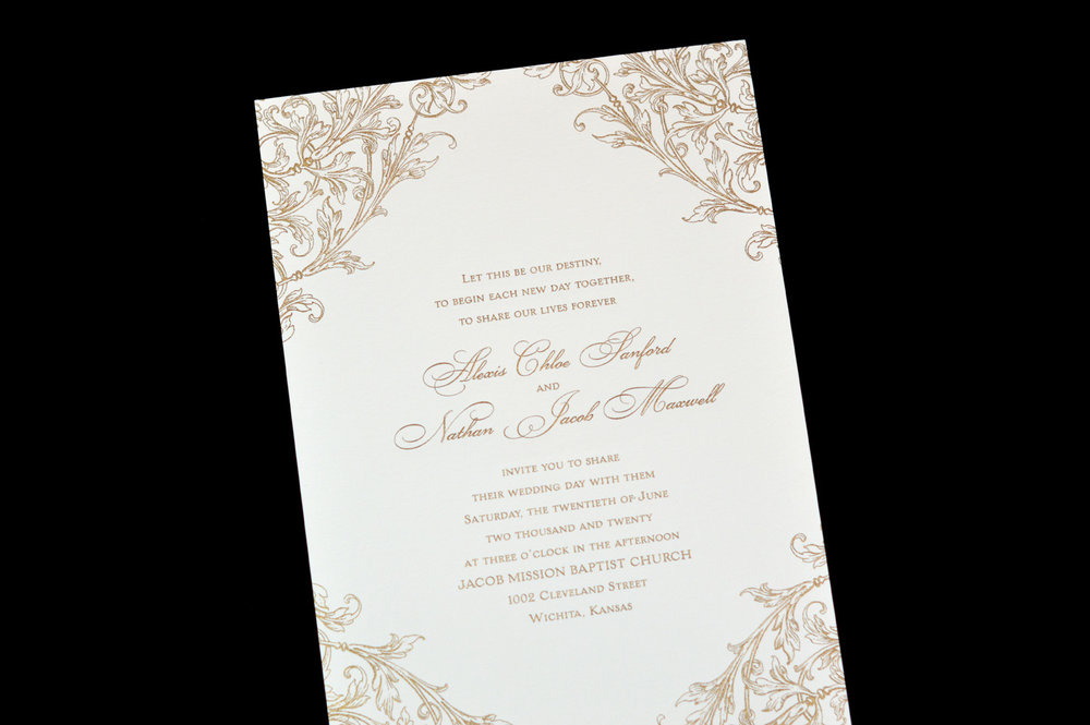 Elegant foil corner motifs accent this invitation.