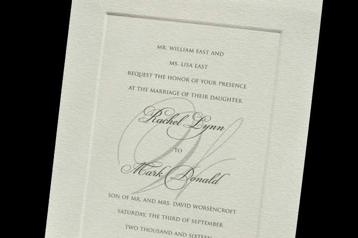 This invitation features a thicker paper and a classic embossed border. A ghosted monogram sit behind the verse.