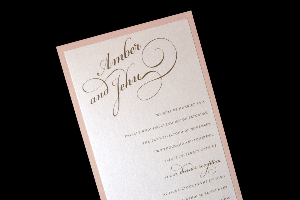 This invitation features an artistic accent on the couple's names.