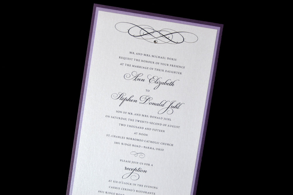 This triple-layer invitation features shades of purple shimmer papers and a rhinestone accent.