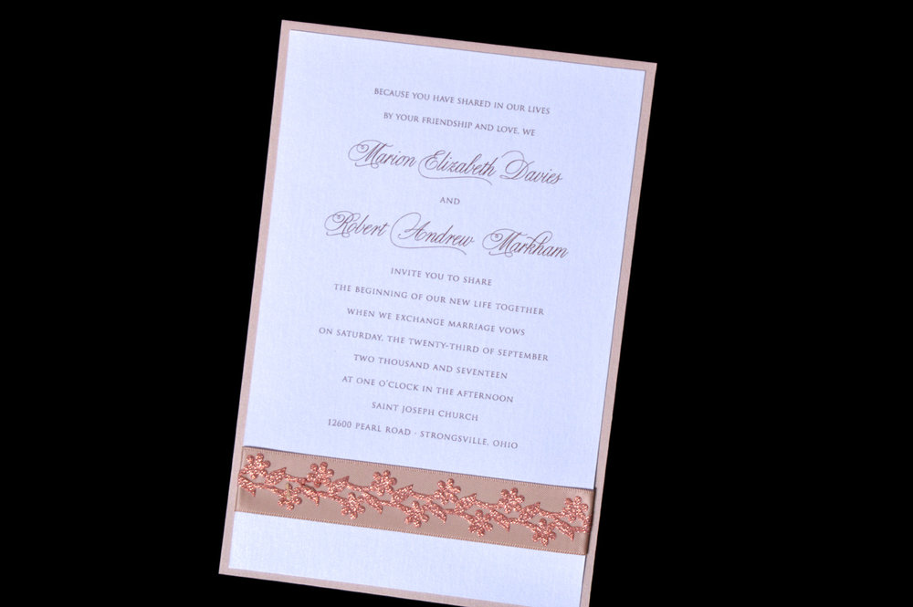 This invitation features champagne satin ribbon with sparkly floral ribbon overlay.