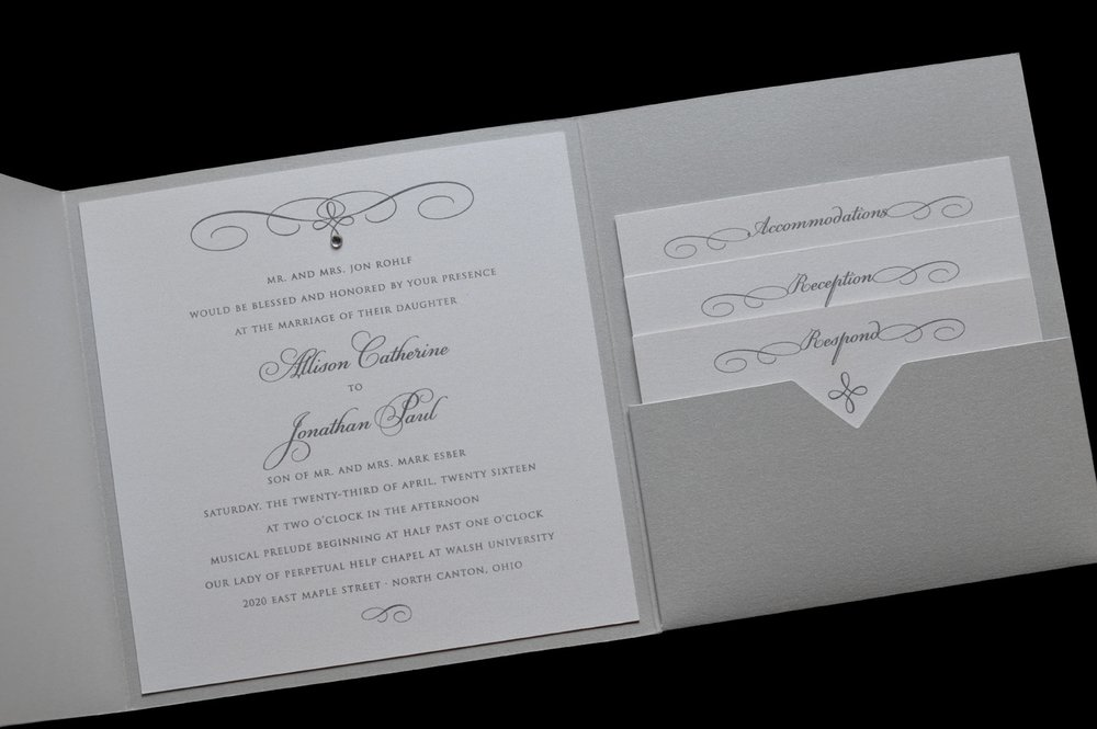 This lovely shimmery silver pocket features a rhinestone gem on the invitation card.