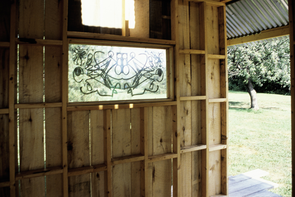"House of Beasts, showing one of the windows and the ""verandah"" surrounding the building."