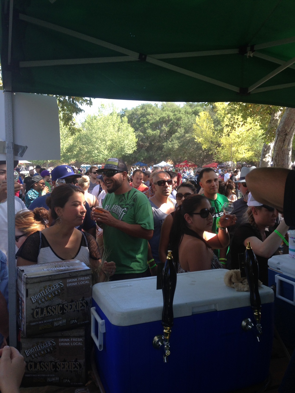 A crowd formed at Bootlegger's booth when the tapped a keg of Knuckle Sandwich a Triple IPA