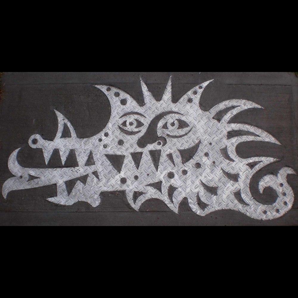 """Dragon Head"", laser cut industrial steel plate, 4'x2', 2002"
