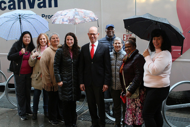Project Renewal staff and supporters braved the rain to celebrate the new ScanVan