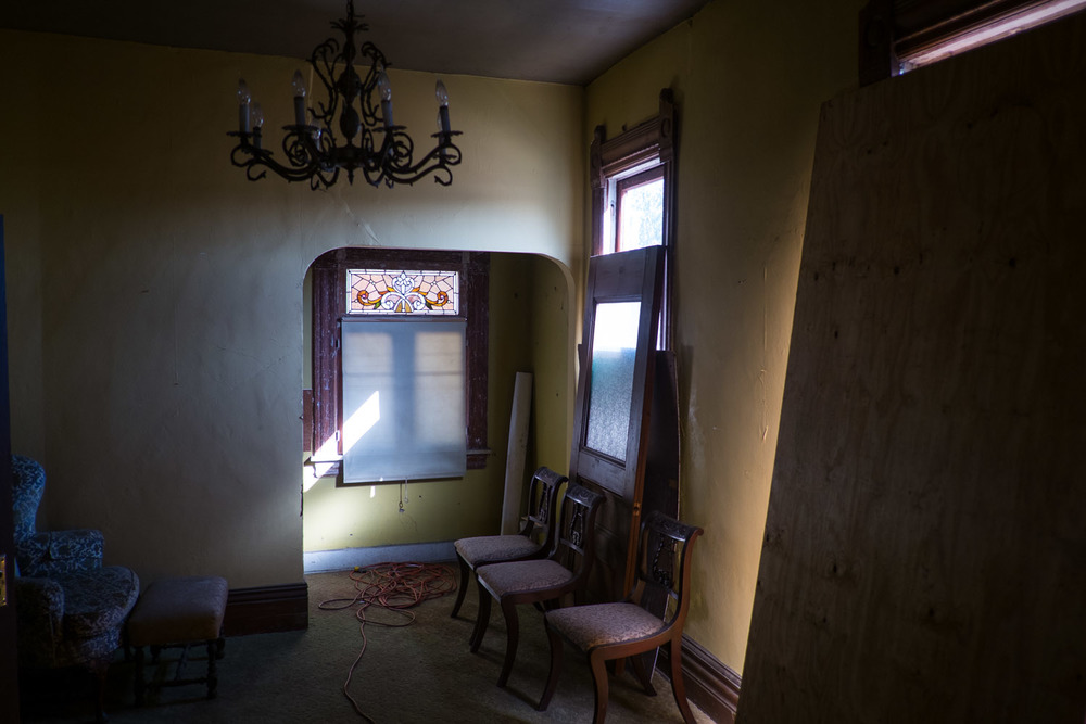 Interior of a Victorian in West Adams with an original stained glass window still intact.