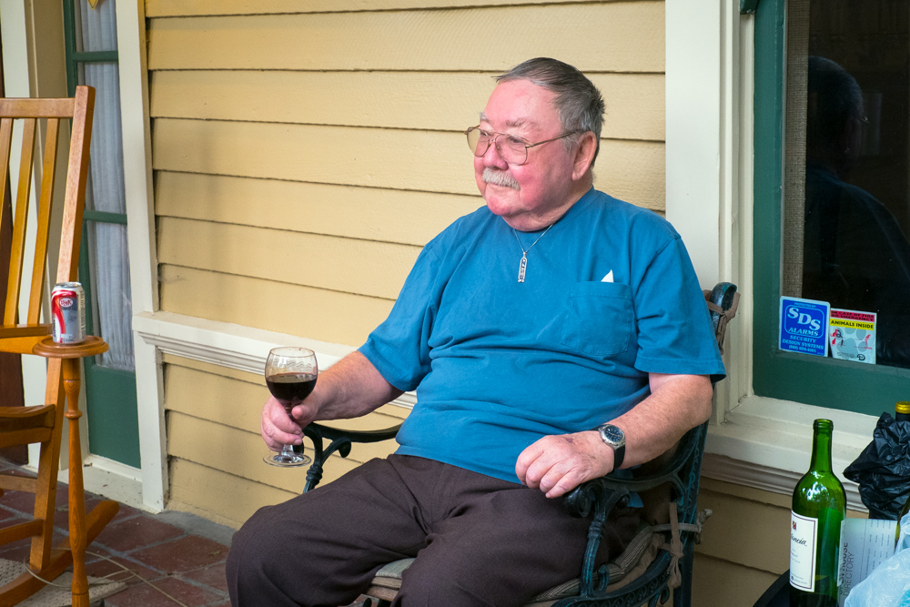 Wally relaxes with a glass of wine.