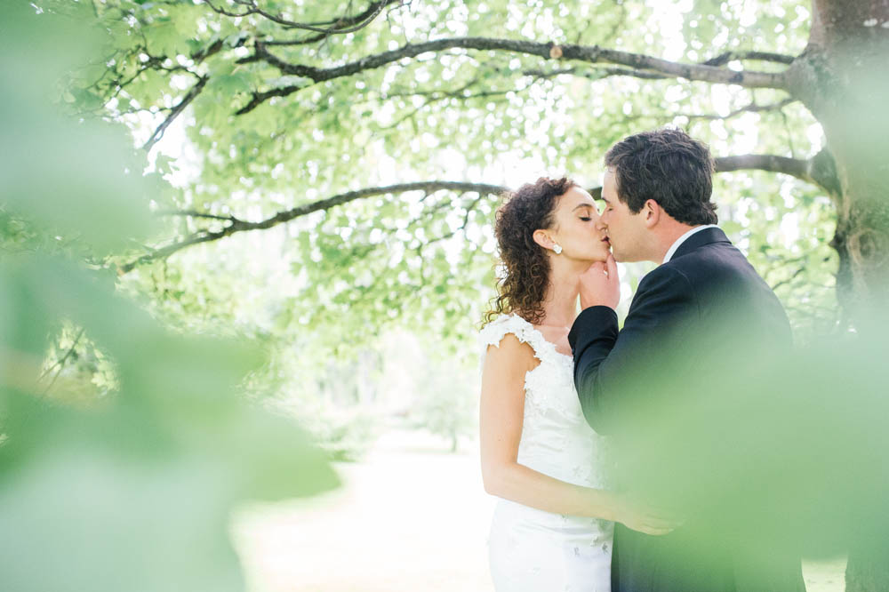 couple-kissing-under-tree.jpg