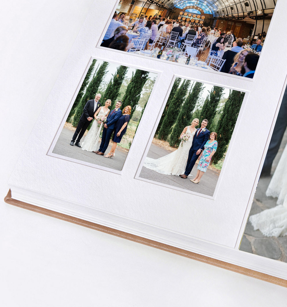The mounting is designed to surround some images and go to the edge of the page for other images. This is a fresh, modern style that simply looks beautiful.