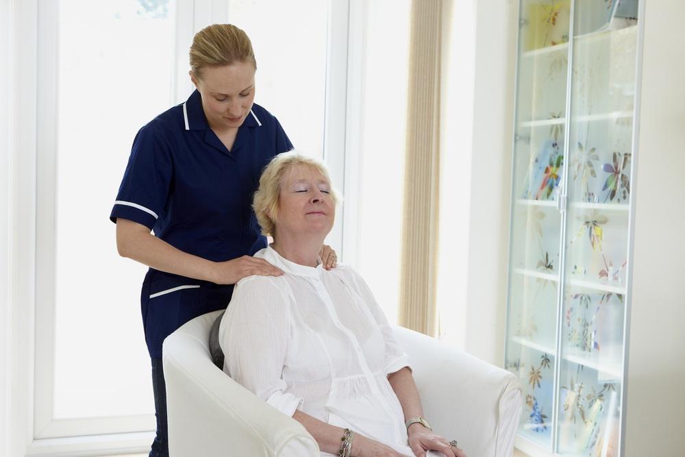 Woman receives neck massage from nurse.jpg