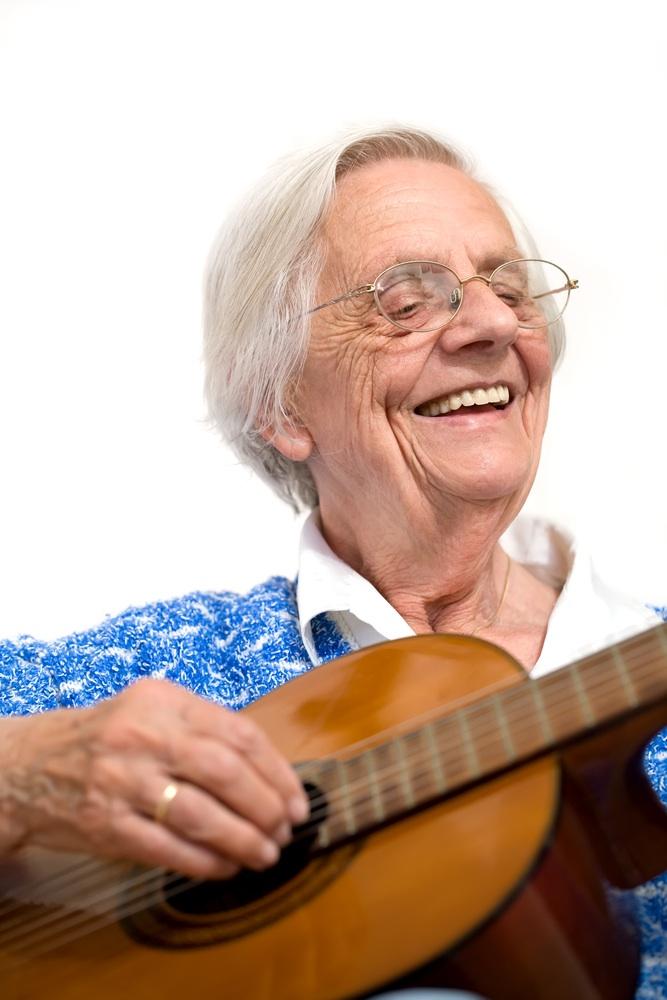 Happy lady playing guitar.jpg