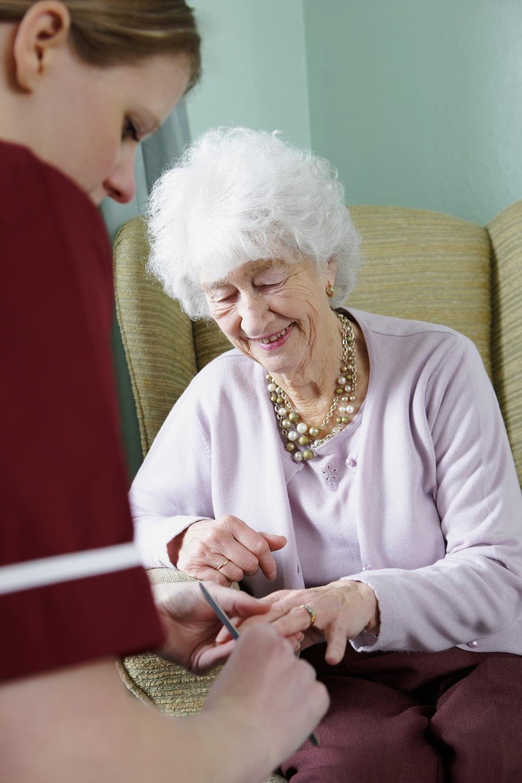 Nurse Aide giving manicure.jpg