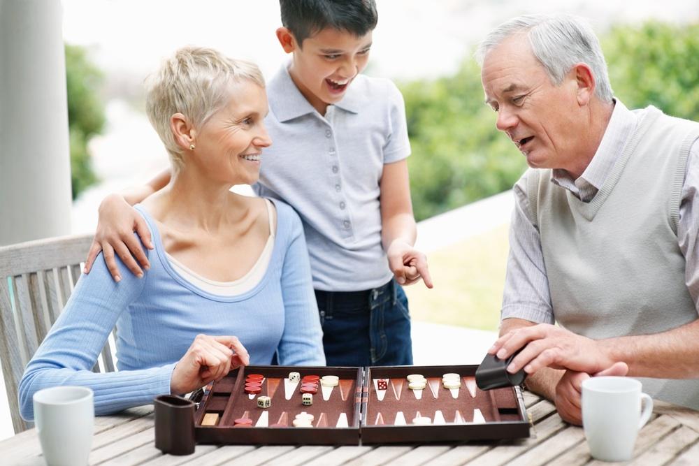 Grandson watches:laughs backgammon.jpg