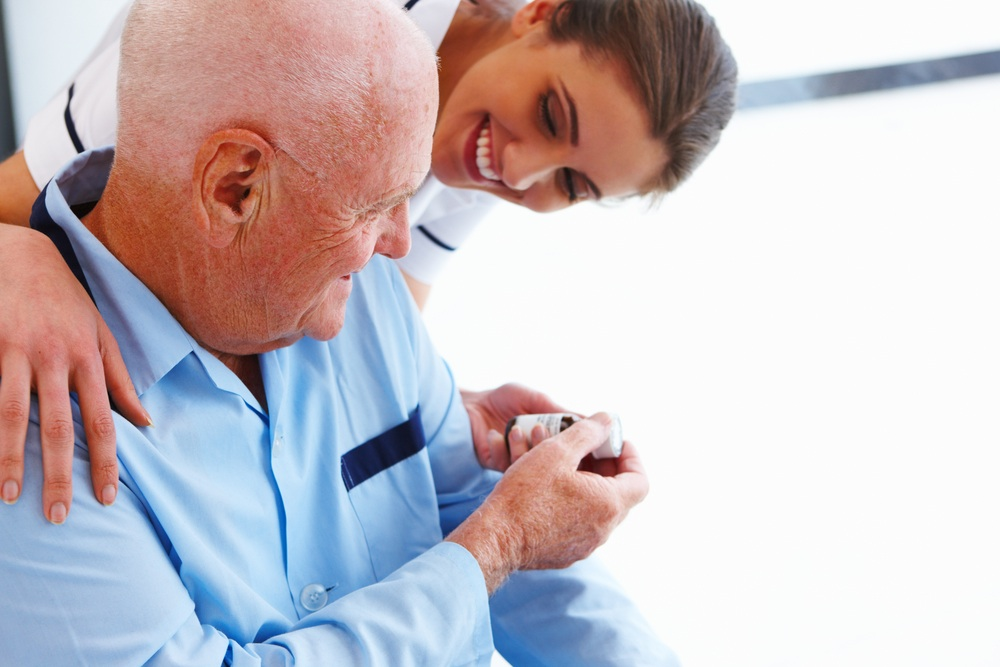 Nurse providing male with vial medicine.jpg