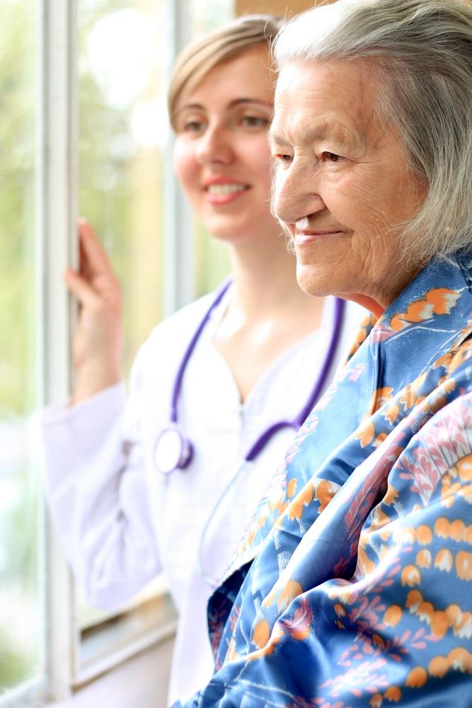 Woman & Nurse looking outside window.jpg