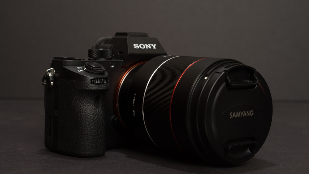 Lately I've been shooting a lot with the Zeiss Batis 85/1.8 and the size of the Samyang is compatible to the Batis.  It's slightly longer and slightly less round.  The feel of the body and focus ring is very similar to the other Sony lenses like the 55FE.  It weighs in at 560g.  It's not light...but doesn't feel overly heavy.  The added size and weight over the 55FE is not surprising, but of course there will be an outcry on the internet about it's size.  I mean, after all, even my 30 year old Canon FD 50/1.4 is half the size of the 55FE.  Below it's pictured with the e-mount adapter attached.  So yeah...the Samyang is bigger and heavier.  Is what it is...don't like it, don't buy it.