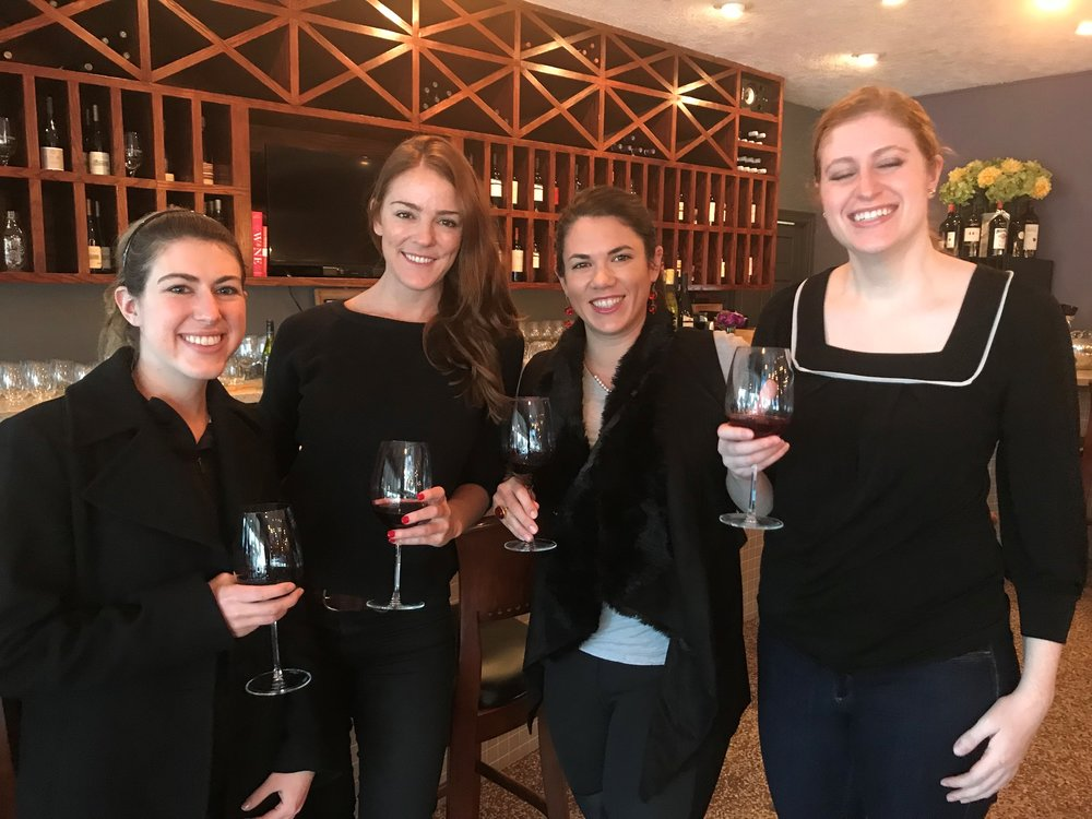 elena's group recently hosted a wine event that brought together group members, faculty, staff, and recent alumni.