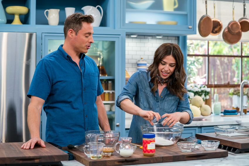 Co-host Jeff Mauro and special guest Molly Yeh as she makes Party Trick Peanut Butter Cake.jpeg
